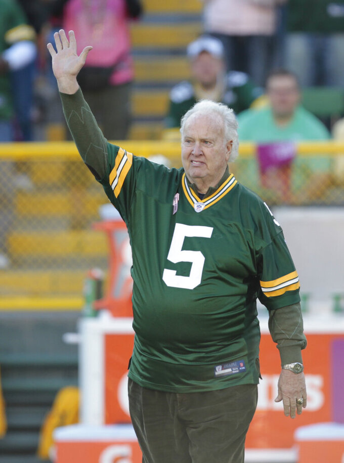 """FILE - In this Oct. 2, 2011 file photo, former Green Bay Packer Paul Hornung waves to the crowd during an NFL football game in Green Bay, Wis. Hornung, the dazzling """"Golden Boy"""" of the Green Bay Packers whose singular ability to generate points as a runner, receiver, quarterback, and kicker helped turn them into an NFL dynasty, has died, Friday, Nov. 13, 2020. He was 84. (AP Photo/Mike Roemer, File)"""