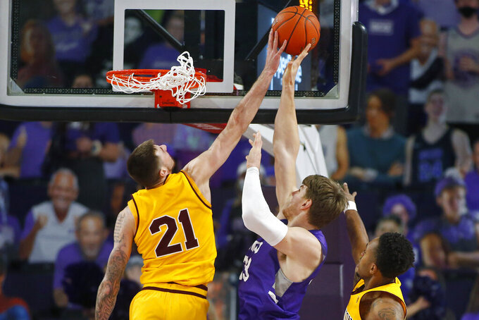 CORRECTS MONTH TO DECEMBER-Arizona State forward Chris Osten (21) blocks the shot of Grand Canyon center Asbjorn Midtgaard (33) during the second half of an NCAA college basketball game, Sunday, Dec. 13, 2020, in Phoenix. (AP Photo/Ralph Freso)