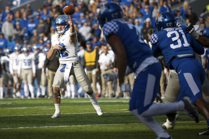 Middle Tennessee quarterback Brent Stockstill (12) passes the ball during the second half of an NCAA college football game against Kentucky in Lexington, Ky., Saturday, Nov. 17, 2018. (AP Photo/Bryan Woolston)
