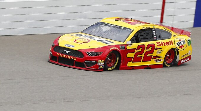 Joey Logano drives enroute to the pole during qualifying for the NASCAR cup series race at Michigan International Speedway, Saturday, June 8, 2019, in Brooklyn, Mich. (AP Photo/Carlos Osorio)