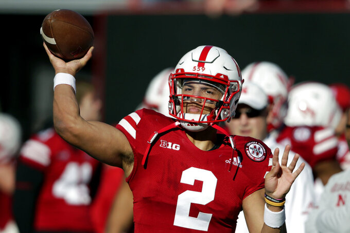 Nebraska quarterback Adrian Martinez (2) warms up before an NCAA college football game against Bethune-Cookman in Lincoln, Neb., Saturday, Oct. 27, 2018. (AP Photo/Nati Harnik)
