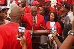 In this April 5, 2019, photo, Botswana's President Mokgweetsi Masisi, center, and his wife Neo, right, are photographed in Gaborone. Botswana's ruling party, the BDF (Botswana Democratic Party), faces the tightest election of its history on Wednesday, Oct. 23, 2019 after former President Ian Khama, annoyed with his hand-picked successor, Masisi, announced his support for the opposition. (AP Photo/Sello Motseta)