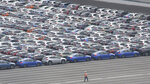 Subaru cars for export park at Kawasaki port, near of Tokyo, Monday, July 8, 2019. Among the challenges awaiting Prime Minister-elect Yoshihide Suga is the urgent challenge of how to keep the world's third-largest economy growing as its population ages and shrinks. (AP Photo/Koji Sasahara)