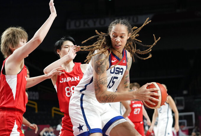 United States' Brittney Griner (15), right, drives past Japan's Maki Takada (8), left, and Himawari Akaho (88), center, during women's basketball preliminary round game at the 2020 Summer Olympics, Friday, July 30, 2021, in Saitama, Japan. (AP Photo/Eric Gay)
