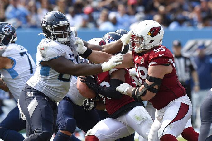 Arizona Cardinals defensive end J.J. Watt (99) plays against Tennessee Titans inside linebacker Rashaan Evans (54) in the second half of an NFL football game Sunday, Sept. 12, 2021, in Nashville, Tenn. (AP Photo/Mark Zaleski)