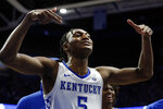 Kentucky's Immanuel Quickley celebrates after an overtime win against Louisville in an NCAA college basketball game in Lexington, Ky., Saturday, Dec. 28, 2019. (AP Photo/James Crisp)