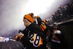 Philadelphia Flyers fans celebrate after Claude Giroux scored the game-winning goal against the Pittsburgh Penguins in an NHL Stadium Series hockey game at Lincoln Financial Field, Saturday, Feb. 23, 2019, in Philadelphia. Philadelphia won 4-3 in overtime. (AP Photo/Matt Rourke)