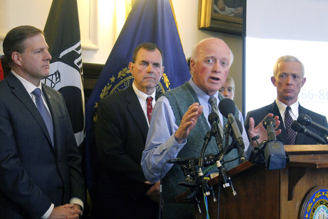 New Hampshire Secretary of State Bill Gardner, second from right, explains the state's efforts to prepare for the upcoming first-in-the-nation presidential primary at a Statehouse news conference Thursday, Feb. 6, 2020, in Concord, N.H. Pictured behind Gardner are from left: Republican Gov. Chris Sununu, New Hampshire U.S. Attorney Scott Murray, Gardner, and New Hampshire Attorney General Gordon MacDonald. (AP Photo/Holly Ramer)