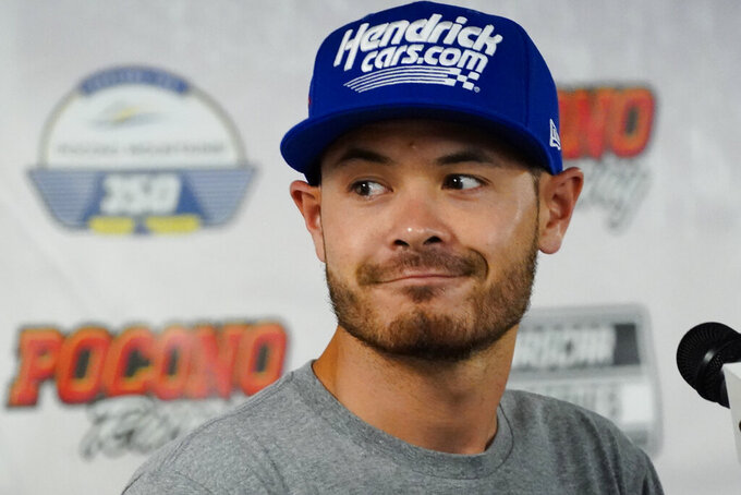 Kyle Larson driver of car 5 in the NASCAR Cup Series, speaks at a news conference before the scheduled races at Pocono Raceway, Sunday, June 27, 2021, in Long Pond, Pa. (AP Photo/Matt Slocum)