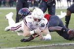 Mississippi State quarterback Tommy Stevens (7) dives into the end zone past Louisville defensive back Khane Pass for a touchdown in the first half of the Music City Bowl NCAA college football game Monday, Dec. 30, 2019, in Nashville, Tenn. (AP Photo/Mark Humphrey)