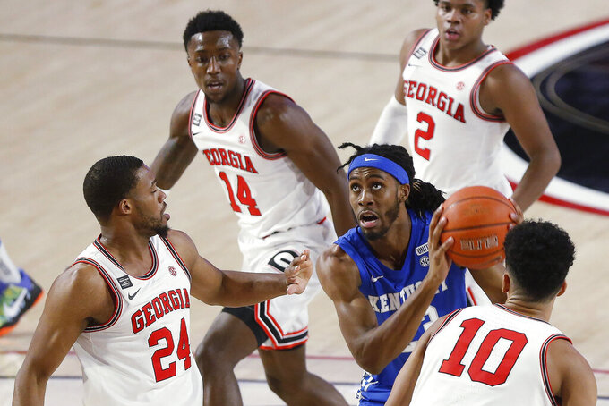 Kentucky's Isaiah Jackson (23) is stopped by Georgia's P.J. Horne (24) and Toumani Camara (10) during an NCAA college basketball game Wednesday, Jan. 20, 2021, in Athens, Ga. (Joshua L. Jones/Athens Banner-Herald via AP)