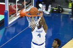 Seton Hall's Tyrese Samuel (4) dunks against Oregon during the first half of an NCAA college basketball game in Omaha, Neb., Friday, Dec. 4, 2020. (AP Photo/Kayla Wolf)