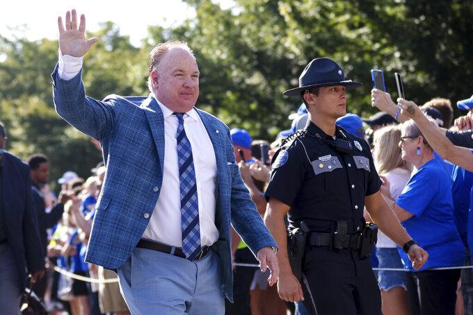 Kentucky head coach Mark Stoops waves to fans before an NCAA college football game against Louisiana-Monroe in Lexington, Ky., Saturday, Sept. 4, 2021. (AP Photo/Michael Clubb)