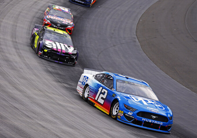 Ryan Blaney (12) leads Jimmie Johnson (48) and Erik Jones (20) during a NASCAR Cup Series auto race, Sunday, April 7, 2019, in Bristol, Tenn. (AP Photo/Wade Payne)