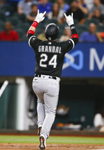 Chicago White Sox's Yasmani Grandal celebrates after hitting a solo home run during the sixth inning of a baseball game against the Texas Rangers, Saturday, Sept. 18, 2021, in Arlington, Texas. (AP Photo/Brandon Wade)