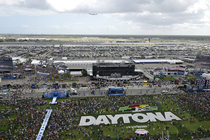 Air Force One, carrying President Donald Trump, makes a pass over Daytona International Speedway before the NASCAR Daytona 500 auto race Sunday, Feb. 16, 2020, in Daytona Beach, Fla. (AP Photo/Phelan M. Ebenhack)