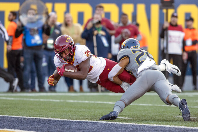Iowa State running back Breece Hall (28) dives for a touchdown while defended West Virginia safety Sean Mahone (29) during the second half of an NCAA college football game Saturday, Oct. 12, 2019, in Morgantown, W.Va. (AP Photo/Raymond Thompson)