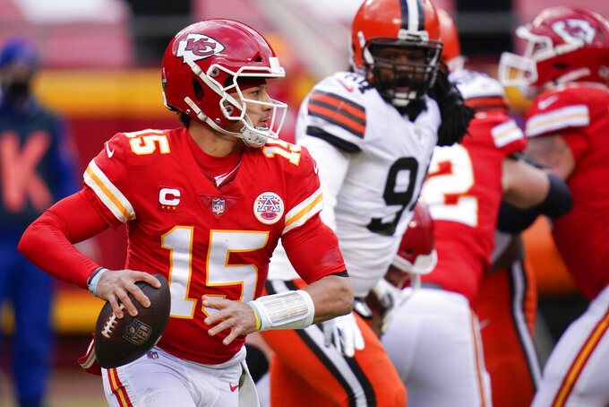 Kansas City Chiefs quarterback Patrick Mahomes looks to pass during the first half of an NFL divisional round football game against the Cleveland Browns, Sunday, Jan. 17, 2021, in Kansas City. (AP Photo/Jeff Roberson)