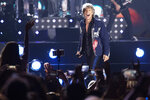 FILE - In this Thursday, July 25, 2019, file photo, singer Jon Bon Jovi performs on a stage during a concert in Tel Aviv, Israel. New Jersey rock royalty was onstage Sunday, Oct. 27, 2019, in the state's musical cradle as rocker Jon Bon Jovi brought soulful crooner Southside Johnny Lyon with him into the New Jersey Hall of Fame. (AP Photo/Ariel Schalit, File)