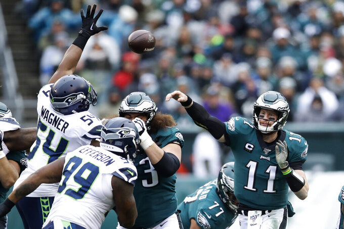 Philadelphia Eagles' Carson Wentz passes during the first half of an NFL football game against the Seattle Seahawks, Sunday, Nov. 24, 2019, in Philadelphia. (AP Photo/Matt Rourke)