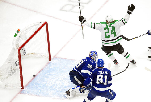 Dallas Stars left wing Roope Hintz (24) reacts as teammate Joel Kiviranta (not shown) scores past Tampa Bay Lightning goaltender Andrei Vasilevskiy (88) during second-period NHL Stanley Cup finals hockey action in Edmonton, Alberta, Saturday, Sept. 19, 2020. (Jason Franson/The Canadian Press via AP)