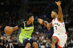 Minnesota Timberwolves guard Jarrett Culver (23) drives against Toronto Raptors guard Kyle Lowry (7) in the first quarter of an NBA basketball game Saturday, Jan. 18, 2020, in Minneapolis. (AP Photo/Andy Clayton-King)
