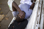 Abu Salem, 30, from Senegal, rests on a park bench in Fraga, Huesca, Spain, Thursday, July 2, 2020. Authorities in northeast Spain have ordered the lockdown of a county around the city of Lleida due to worrying outbreaks of the COVID-19 virus. Catalan regional authorities announced Saturday, July 4, 2020 that as of noon local time movement will be restricted to and from the county of El Segriá around Lleida which is home to over 200,000 people. Residents will have until 4 p.m. to enter the area. The new outbreaks are linked to agricultural workers in the rural area.  (AP Photo/Emilio Morenatti)