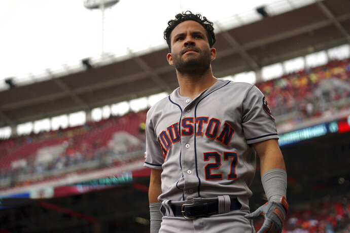 Houston Astros' Jose Altuve prepares to bat in the first inning of a baseball game against the Cincinnati Reds, Wednesday, June 19, 2019, in Cincinnati. (AP Photo/Aaron Doster)
