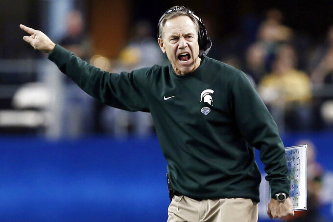 FILE - In this Jan. 1, 2015, file photo, Michigan State head coach Mark Dantonio argues a call during the first half of the Cotton Bowl NCAA college football game against Baylor in Arlington, Texas. Dantonio announced his retirement Tuesday, Feb. 4, 2020, ending a 13-year run in which he guided the Spartans to heights they hadn't reached in decades.   (AP Photo/Brandon Wade, File)