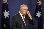 Australia's Prime Minister Scott Morrison attends a press conference in Sydney, Australia, on April 27, 2021. U.S. President Joe Biden, his Chinese counterpart Xi Jinping, Japanese Prime Minister Yoshihide Suga and Russian President Vladimir Putin are among Pacific Rim leaders gathering for a virtual meeting on Friday, July 16, 2021, to discuss strategies to help economies rebound from a resurgent COVID-19 pandemic. (AP Photo/Rick Rycroft)