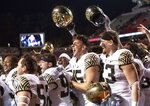 Wake Forest players celebrate after defeating North Carolina State in an NCAA college football game in Raleigh, N.C., Thursday, Nov. 8, 2018. (AP Photo/Ben McKeown)