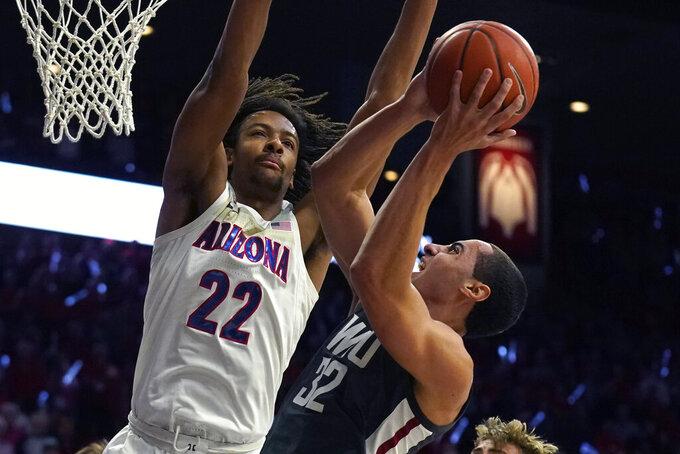 Washington State forward Tony Miller (32) drives against Arizona forward Zeke Nnaji in the first half of an NCAA college basketball game Thursday, March 5, 2020, in Tucson, Ariz. (AP Photo/Rick Scuteri)