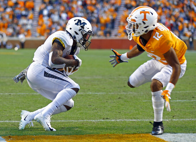 Missouri wide receiver Johnathon Johnson (12) catches a touchdown pass as he's defended by Tennessee defensive back Shawn Shamburger (12) in the first half of an NCAA college football game Saturday, Nov. 17, 2018, in Knoxville, Tenn. (AP Photo/Wade Payne)