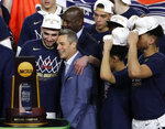 Virginia head coach Tony Bennett, center, celebrates with guard Ty Jerome, left, after the championship game against Texas Tech in the Final Four NCAA college basketball tournament, Monday, April 8, 2019, in Minneapolis. Virginia won 85-77 in overtime. (AP Photo/Matt York)