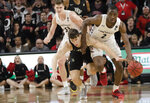 Cincinnati guard Keith Williams (2) drives past Central Florida guard Matt Milon (2) during the second half of an NCAA college basketball game Wednesday, Feb. 19, 2020, in Cincinnati. (Albert Cesare/The Cincinnati Enquirer via AP)