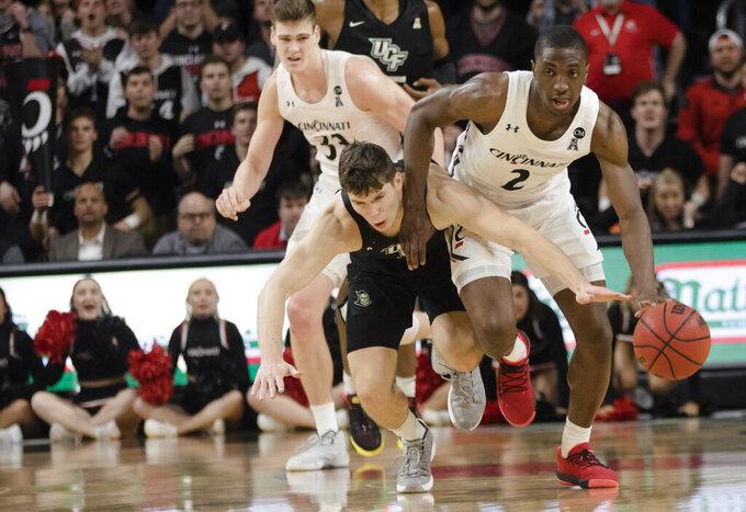 Cincinnati guard Keith Williams (2) drives past Central Florida guard Matt Milon (2) during the second half of an NCAA college basketball game Wednesday, Feb. 19, 2020, in Cincinnati. (Albert Cesare/The Cincinnati Enquirer via AP)