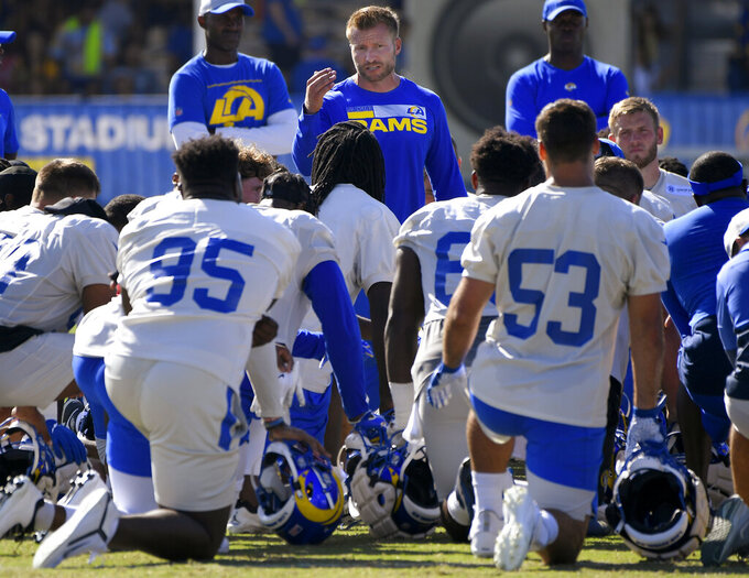 Los Angeles Rams coach Sean McVay talks to players during NFL football training camp Friday, Aug 6, 2021, in Irvine, Calif. (AP Photo/John McCoy)