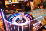 In this June 20, 2019 photo, a dealer throws the roulette ball during a game at the Hard Rock casino in Atlantic City, N.J. New Jersey's casinos won nearly $3.3 billion from gamblers in 2019, the first time since 2012 that the Atlantic City gambling halls had won more than $3 billion, according to figures released Tuesday, Jan. 14, 2020, by the New Jersey Division of Gaming Enforcement.  (AP Photo/Wayne Parry)