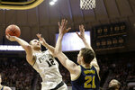 Purdue forward Evan Boudreaux (12) goes up for two over Michigan guard Franz Wagner (21) during the first half of an NCAA college basketball game, Saturday, Feb. 22, 2020, in West Lafayette, Ind. (Nikos Frazier/Journal & Courier via AP)