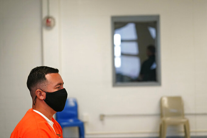 Immigration detainee Alexander Martinez speaks during an interview with The Associated Press, while ICE and facility personnel wait outside in the hallway, at the Winn Correctional Center in Winnfield, La., Friday, July 30, 2021. The number of people in federal immigration detention has risen markedly under President Joe Biden.  (AP Photo/Gerald Herbert)