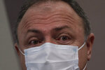 Brazil's former Health Minister Eduardo Pazuello testifies before the Senate for an investigation of the government's management of the COVID-19 pandemic in Brasilia, Brazil, Wednesday, May 19, 2021. (AP Photo/Eraldo Peres)