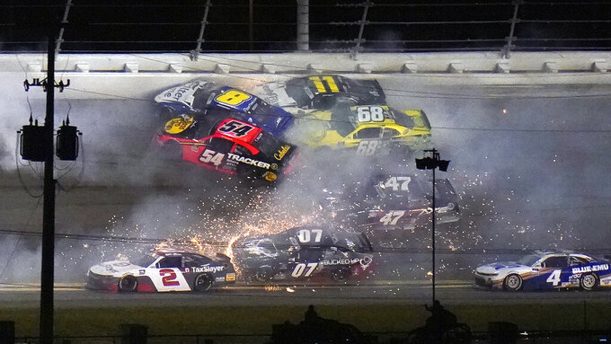 Ty Dillon (54), Josh Berry (8), Justin Haley (11), and Brandon Brown (68) crash during a NASCAR Xfinity Series auto race Saturday, Feb. 13, 2021, at the Daytona International Speedway in Daytona Beach, Fla. (AP Photo/Chris O'Meara)