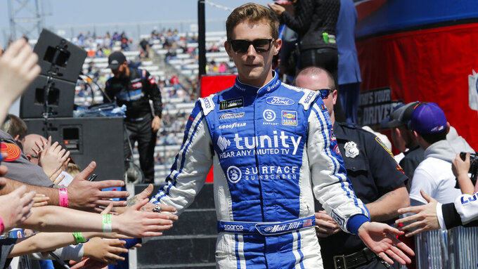 NASCAR Cup Series driver Matt Tifft (36) greets fans during driver introductions prior to the NASCAR Cup Series auto race at the Martinsville Speedway in Martinsville, Va., Sunday, March 24, 2019. (AP Photo/Steve Helber)