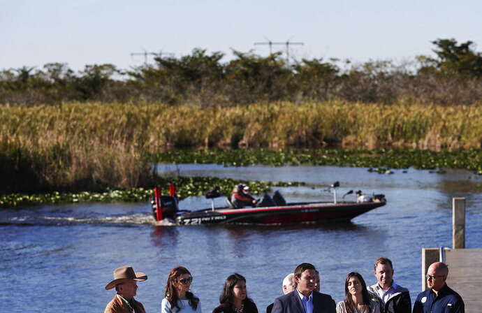 FILE - In this Jan. 29, 2019, file photo, Florida Gov. Ron DeSantis speaks about his environmental budget at the Everglades Holiday Park during a new conference in Fort Lauderdale, Fla. A federal judge on Monday, Feb. 11, refused to end a decades-old court order that oversees water quality and environmental restoration in the sensitive Florida Everglades. (AP Photo/Brynn Anderson, File)