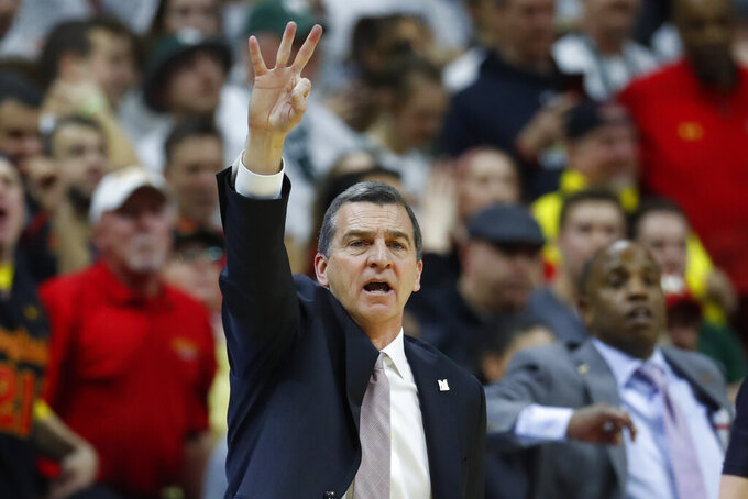 Maryland head coach Mark Turgeon signals a play against Michigan State in the second half of an NCAA college basketball game in East Lansing, Mich., Saturday, Feb. 15, 2020. (AP Photo/Paul Sancya)