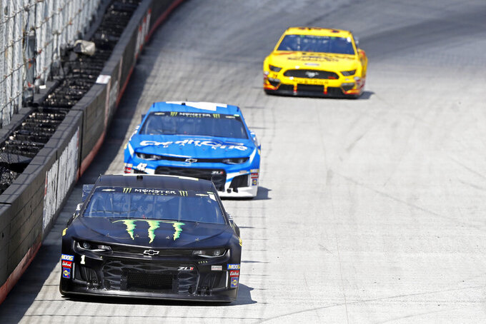 Driver Kurt Busch (1) leads Kyle Larson (42) and Michael McDowell down the back straight during practice for a NASCAR Cup Series auto race, Friday, Aug. 16, 2019, in Bristol, Tenn. (AP Photo/Wade Payne)