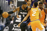 Orlando Magic's Terrence Ross (8) collides with Phoenix Suns' Elie Okobo (2) during the first half of an NBA basketball game Friday, Jan. 10, 2020, in Phoenix. (AP Photo/Darryl Webb)