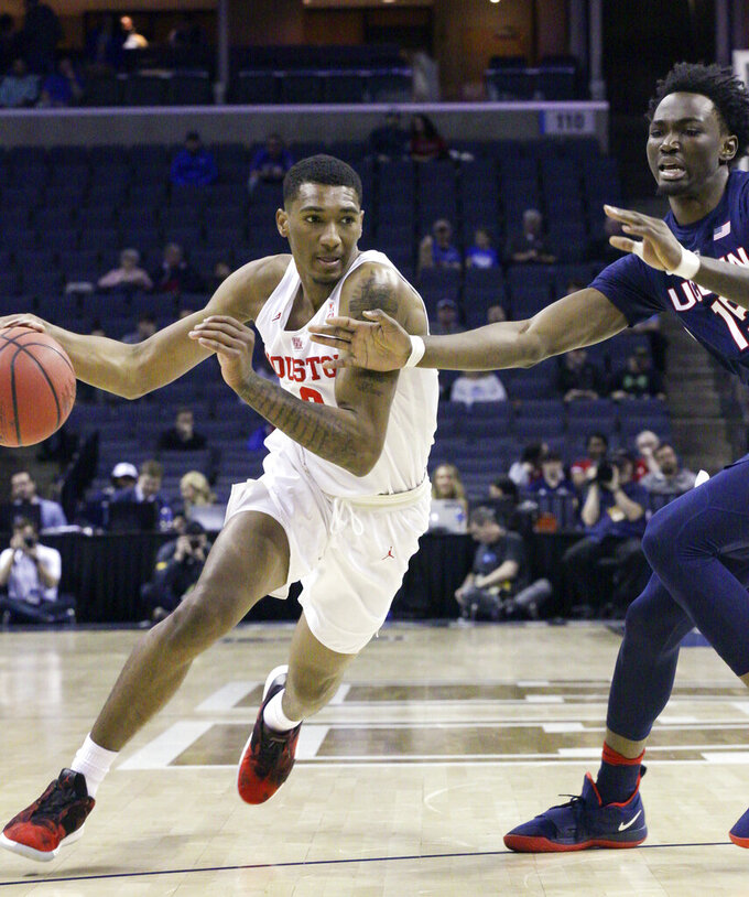 Davis scores 22 to lead No. 11 Houston past UConn 84-45