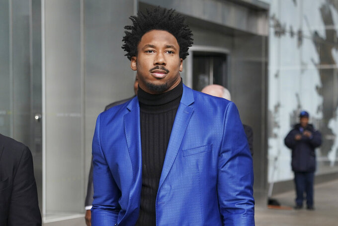 FILE - In this Nov. 20, 2019 file photo Myles Garrett leaves an office building in New York. The Cleveland Browns will exercise the fifth-year contract options on star defensive end Myles Garrett and tight end David Njoku, a person familiar with the decisions told the Associated Press on Monday, April 27, 2020. The decision on Garett was no surprise and will be official later in the day, said the person who spoke on condition of anonymity because the team has not publicly revealed its plans. (AP Photo/Seth Wenig, file)