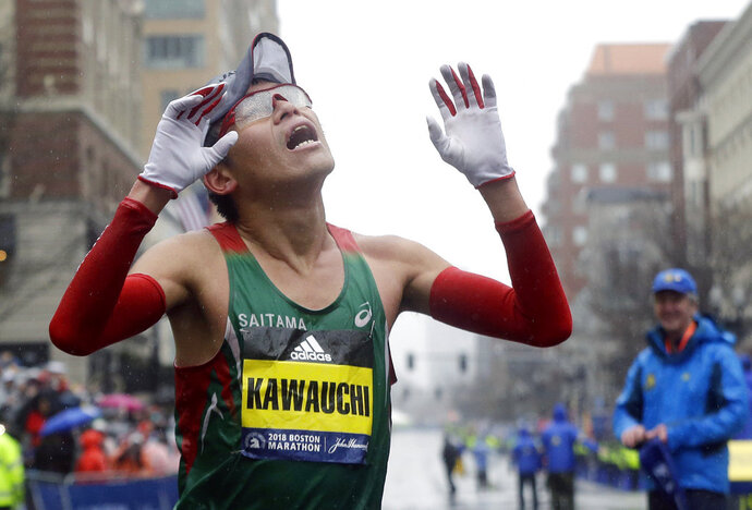Yuki Kawauchi, of Japan, celebrates after winning the 122nd Boston Marathon on Monday, April 16, 2018, in Boston. He is the first Japanese man to win the race since 1987. (AP Photo/Elise Amendola)